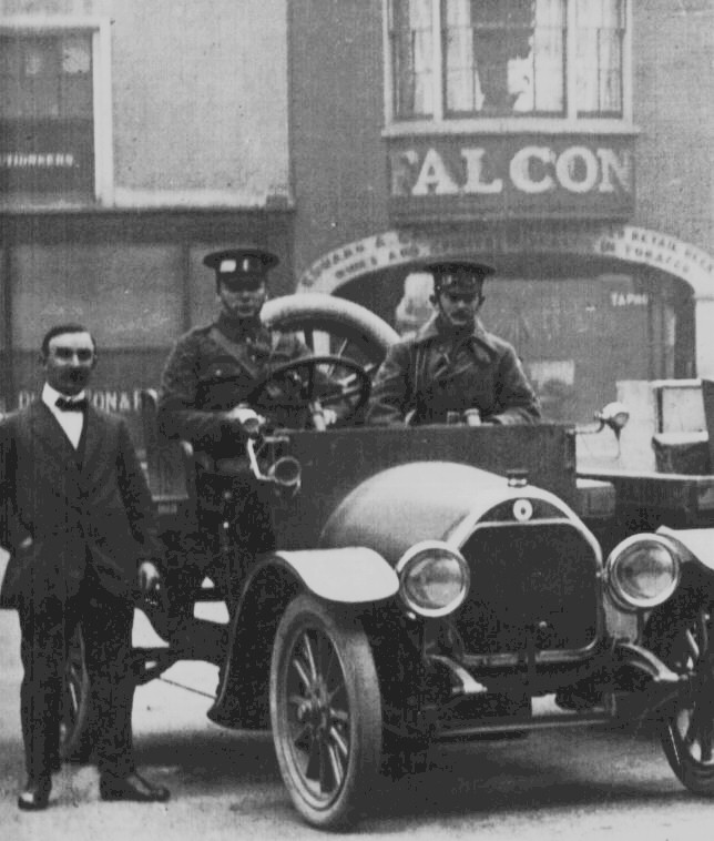 These photos are of the transport section of the HCB the one to the left is   taken outside the 'Falcon' public house in Market Square Huntingdon.  Its location is almost on the same spot as the Huntingdon War memorial was located after the war. there was some communication in the local press and between interested parties at the time of the planning of the memorial that the statue should be of a Hunts. Cyclist, but, after heated debate,  it was decided to erect a statue of  ' A Thinking Soldier' .  The photo is only a small part of a larger photo showing a line of seven cars all converted for the use of the H C B by the local garage Messrs. Murket Bros..   Mr. Murket can be seen standing next to the car.